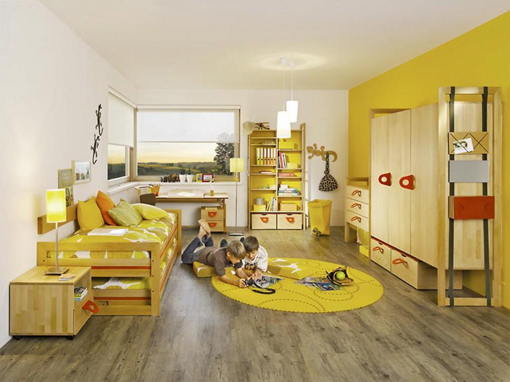 Wände, Accessoires und Dekorationsgegenstände in helleren, freundlichen Farben wie Gelb, Orange oder Pink verleihen dem Kinderzimmer eine positive Ausstrahlung. Bildquelle: tdx/Team 7