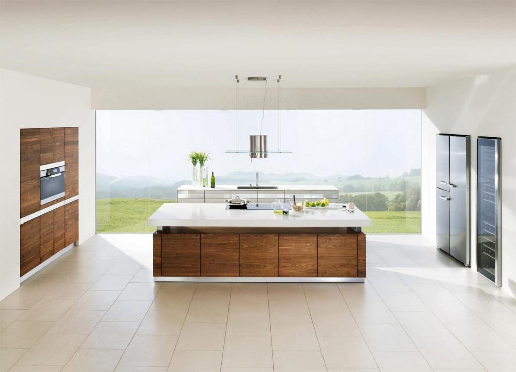 Grifflose Fronten, klare Linien und helle Oberflächen in Kombination mit Edelhölzern sind im Trend und verleihen der Küche einen gemütlichen, wohnlichen Charakter. Bild: tdx/Team7