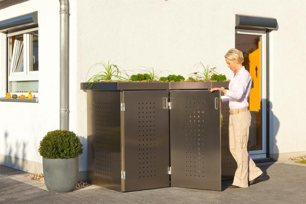 Mülltonnenboxen schaffen ein attraktives Bild und verstecken die Behälter. Besonders bewährt hat sich das System Binto, beispielweise in Edelstahl mit Pflanzschalendeckel, von Brügmann TraumGarten. Bild: tdx/Brügmann TraumGarten